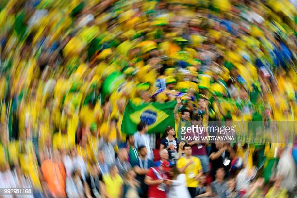 TOPSHOT Brazil supporters cheer during the Russia 2018 World Cup quarterfinal football match between Brazil and Belgium at the Kazan Arena in Kazan...
