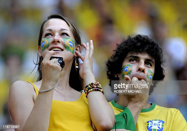 Brazil supporters cheer prior to the quarterfinal match of the FIFA women's football World Cup Brazil vs USA on July 10 2011 in Dresden eastern...