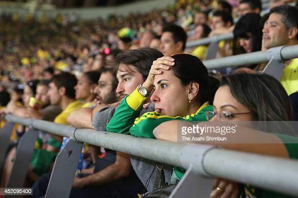 Brazil supporters look dejected during the 2014 FIFA World Cup Brazil Third Place Playoff match between Brazil and the Netherlands at Estadio...