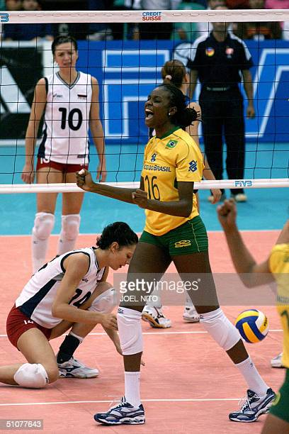 Brazil volleyball player Claudino Faviana gestures during the second day of the World Grand Grix Womens volleyball in Manila 18 July 2004 Brazil won...