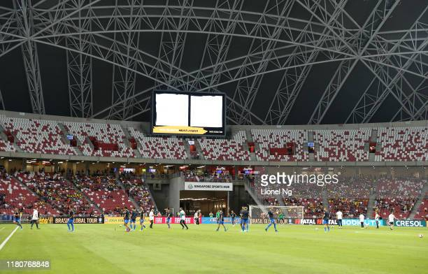 Brazil warms up before the international friendly match between Brazil and Nigeria at the Singapore National Stadium on October 13, 2019 in Singapore.