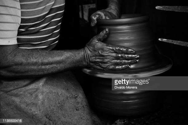 brazil - workers - potters - artisans - ceramics workers - divaldo moreira stock photos and pictures