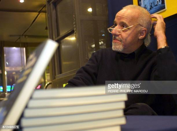 Brazilain author Paulo Coelho autographs 08 February 2001 copies of his newlyreleased book 'El demonio y la senorita Prym' at a booksigning ceremony...