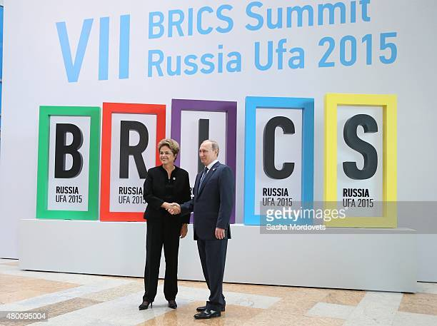 Brazilain President Dilma Rousseff greets President Vladimir Putin during the BRICS 2015 Summit in Ufa Russia July2015 Leaders of China Russia Brasil...