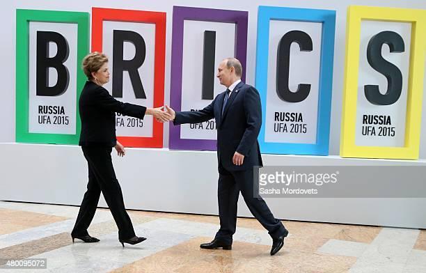 Brazilain President Dilma Rousseff greets President Vladimir Putin during the BRICS 2015 Summit in Ufa Russia July2015 Leaders of China Russia Brasil...