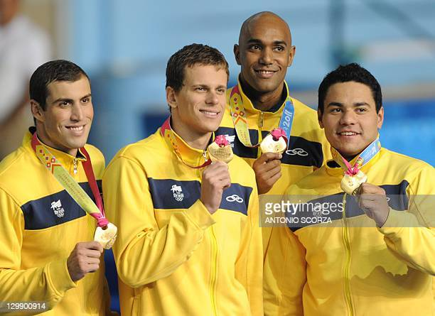 Brazilan swimmers, with among them Cesar Cielo , pose with their gold medal on the podium of the men's 4x100-metre medley relay during the 2011 Pan...