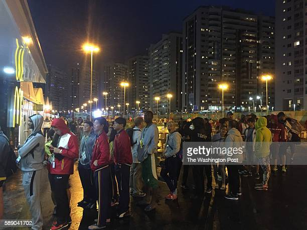 JANEIRO BRAZILAthletes and others from the Olympic Village line up for McDonald's