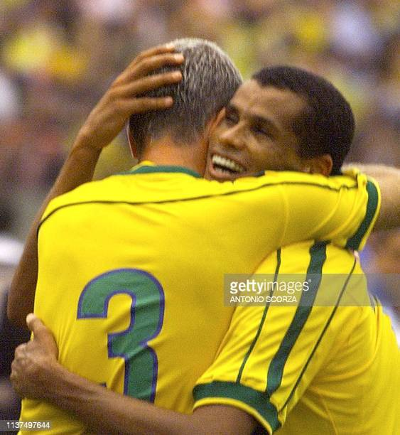 Brazilean player Rivaldo celebrates his second goal against Argentina with teammate Antonio Carlos 07 September 1999 during a friendly game between...