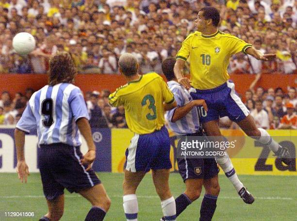 Brazilean player Rivaldo jumps while Argentinian player Hernan Crespo watches 07 September 1999 during a friendly game between the teams from Brazil...