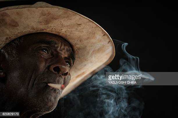 Brazilian 76yearold farmer Jose Pascualsmokes tobacco in Paracatu de Baixo village which has been ruined by the flood following the collapse of...
