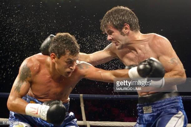 Brazilian Acelino Popo Freitas and Argentine Fernando Saucedo exchange blows in a featherweight fight at the Ibirapuera arena in Sao Paulo Brazil 11...