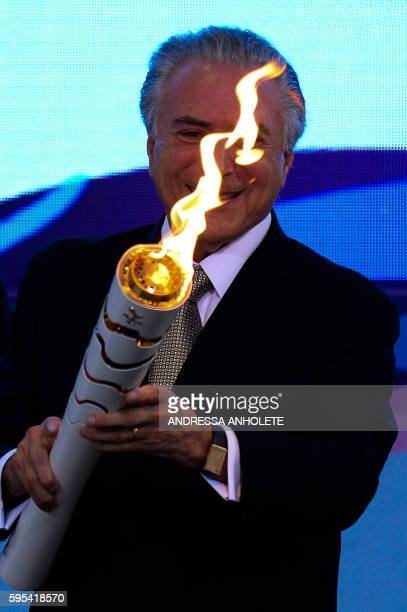 Brazilian acting President Michel Temer attends the reception ceremony of the Paralympic Torch at Planalto Palace in Brasilia on August 25 2016 The...