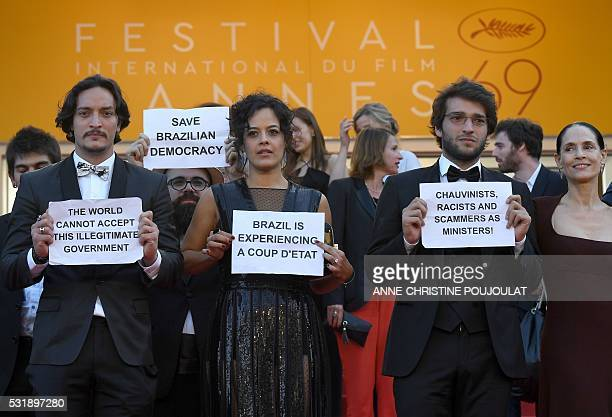 Brazilian actor Allan Souza Brazilian actress Maeve Jinkings Brazilian actor Humberto Carrao and Brazilian actress Sonia Braga hold protest signs as...
