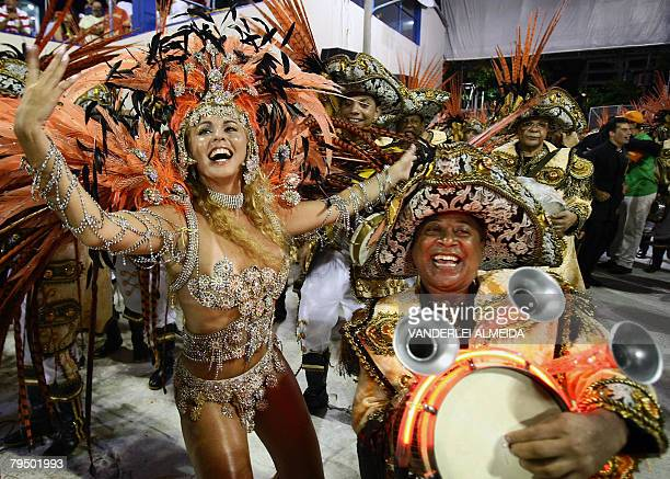 Brazilian actress and Queen of the drummers of the Sao Clemente samba school Bruna de Almeida dances during the first night of the carnival parade at...