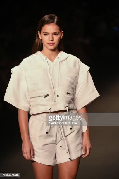 Brazilian actress Bruna Marquezine presents a creation by CocaCola jeans during the Fashion Rio 2015 Summer collection in Rio de Janeiro Brazil on...