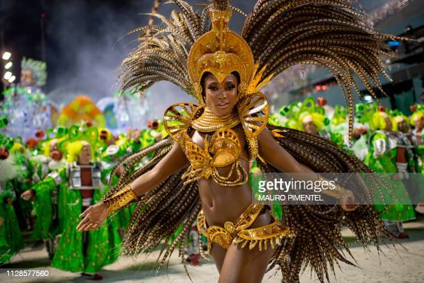 Brazilian actress Erika Januza performs with members of the Grande Rio samba school during the first night of Rio's Carnival at the Sambadrome in Rio...