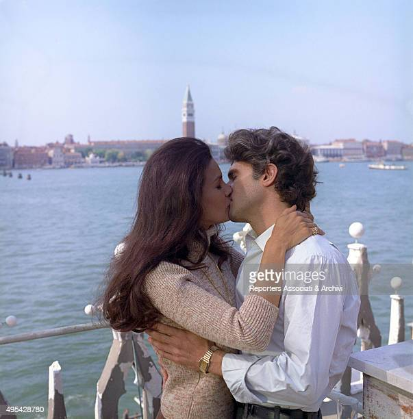 Brazilian actress Florinda Bolkan and American actor Tony Musante kissing each other in a scene from the film The Anonymous Venetian Venice 1970