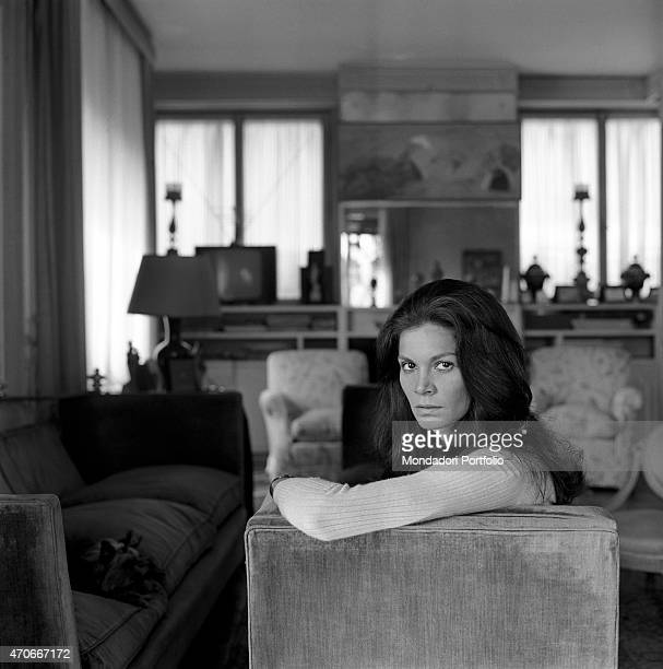 Brazilian actress Florinda Bolkan Florinda Soares BulcÆo's stage name poses looking at the camera and sitting on the sofa in the living room of her...