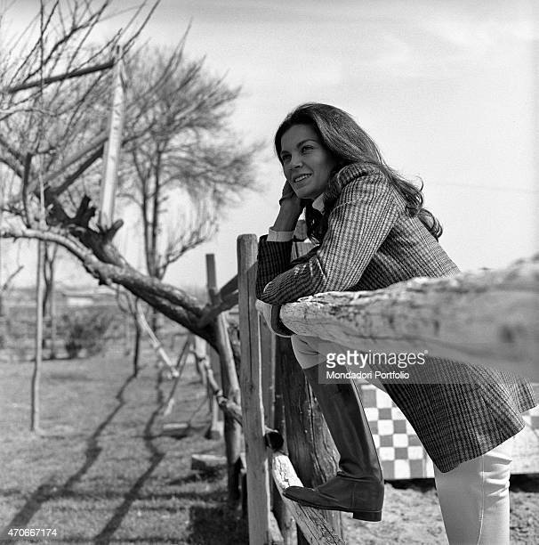Brazilian actress Florinda Bolkan Florinda Soares BulcÆo's stage name is in riding clothes and leans against a fence at Tor di Quinto riding stables...