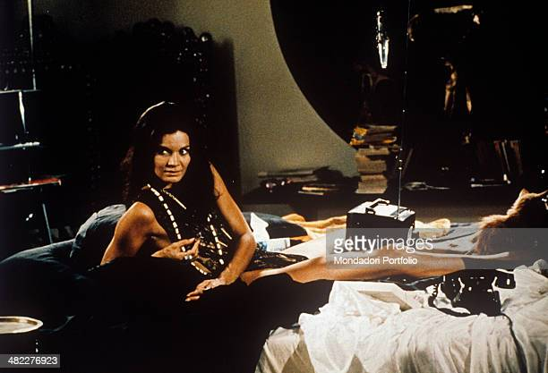 Brazilian actress Florinda Bolkan lying on a bed in the film Investigation of a Citizen Above Suspicion 1970