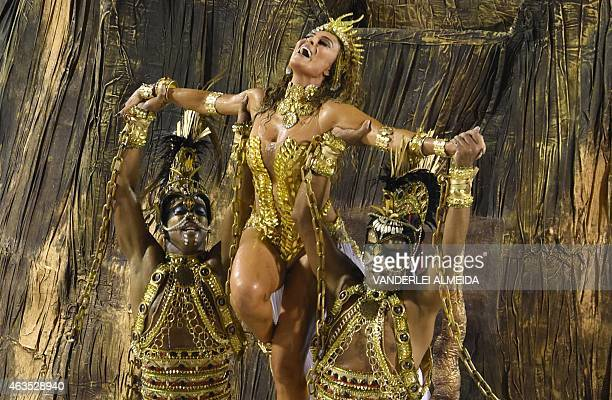 Brazilian actress Juliana Paes performs with Unidos do Viradouro samba school during the first day of the carnival parade at the Sambodromo in Rio de...