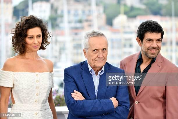Brazilian actress Maria Fernanda Candido Italian film director Marco Bellocchio and Italian actor Pierfrancesco Favino pose during a photocall for...