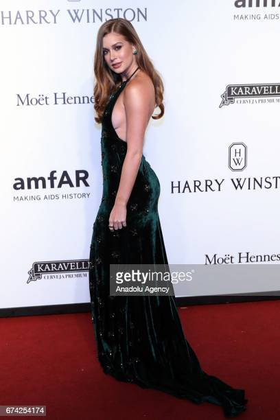 Brazilian actress Marina Ruy Barbosa poses for a photo on the red carpet of The Foundation for AIDS Research event in Sao Paulo Brazil on April 27...