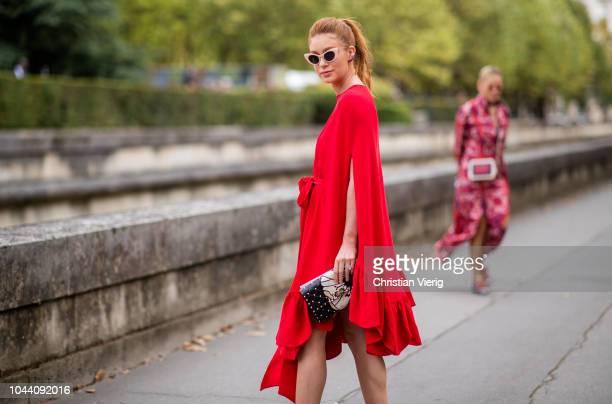 Brazilian actress Marina Ruy Barbosa wearing red dress, heels is seen outside Valentino during Paris Fashion Week Womenswear Spring/Summer 2019 on...