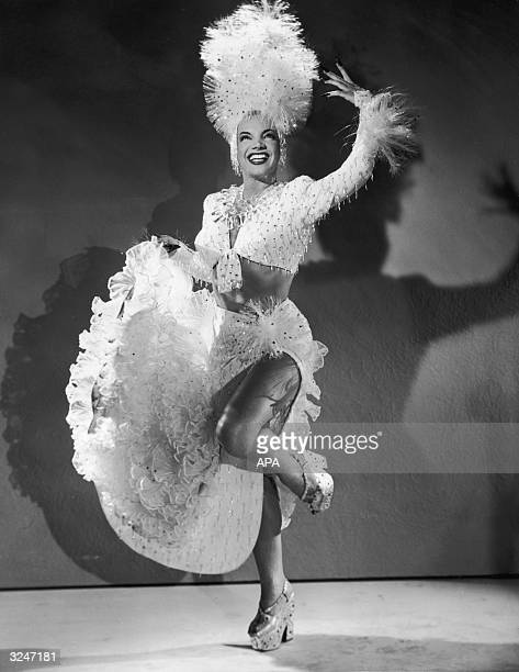 Brazilian actress singer and dancer Carmen Miranda wearing a $1900 plastic costume with matching headdress and platform shoes in a promotional...