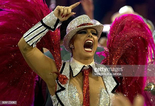 Brazilian actress Viviane Araujo of Academicos do Salgueiro samba school perform during the second night of the carnival parade at Sambadrome in Rio...