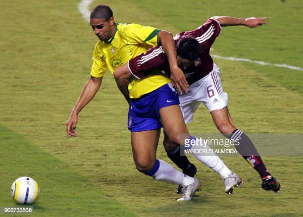Brazilian Adriano and Venezuelan player Alejandro Cichero vies for the ball during their FIFA World Cup Germany 2006 qualifying match at Mangueirao...
