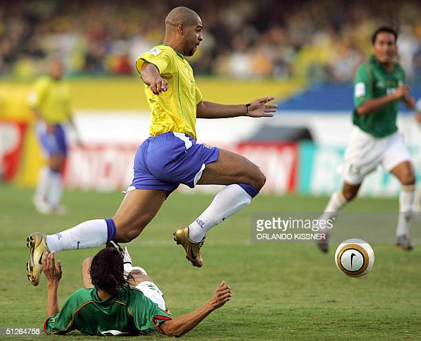 Brazilian Adriano controls the ball despite the mark of Bolivian Luis Cristaldo during a match held at the Morumbi stadium in Sao Paulo 05 September...