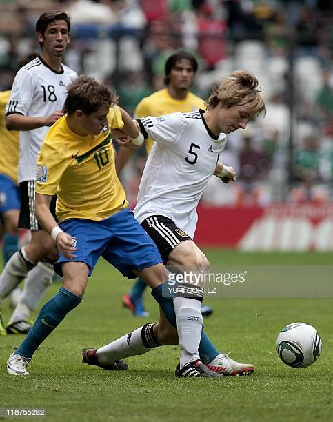 Brazilian Adryan battles for the ball with German Nico Perrey during their U-17 World Cup Football match for the third place at the Azteca stadium in...