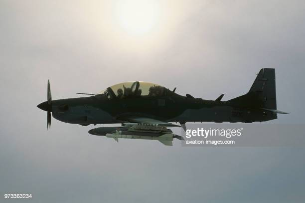 Brazilian Air Force Embraer EMB314 Super Tucano flying with clouds