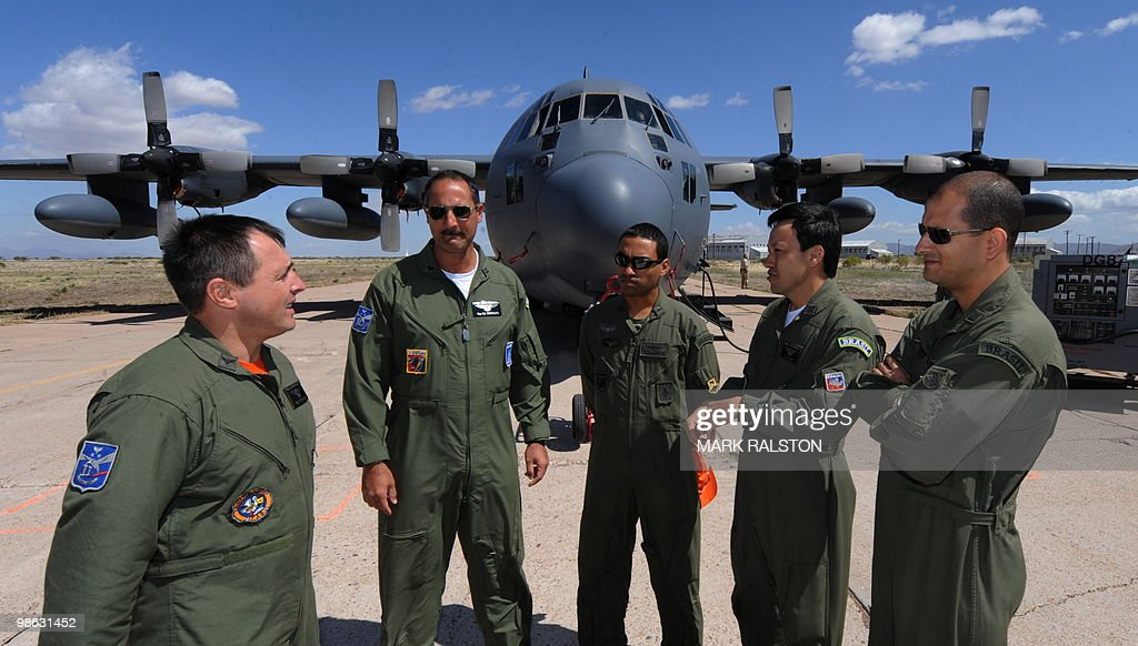 Brazilian Air Force observors (L-R) Major Potiguara, Ten Cel Marques, Ten Lourival, Ten Cel Sun and Ten Roque stand in front of a C-130 plane before a rescue operation during Exercise Angel Thunder, near the town of Bisbee in Arizona's Sonoran Desert on April 21, 2010. Exercise Angel Thunder simulates personnel recovery missions behind enemy lines and is the largest Department of Defense personnel recovery exercise to date. International observors from from Australia, Brazil, Canada, Chile, Colombia, Denmark, France, Germany, Netherlands, and United Kingdom took part in the event.. AFP PHOTO/Mark RALSTON