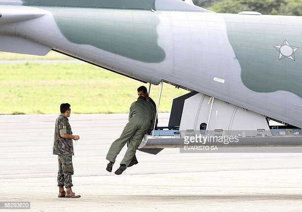 Brazilian Air Force remote sensing R99 aircraft crew men stand by for take off at Fernando de Noronha airport to partake in a search mission to find...