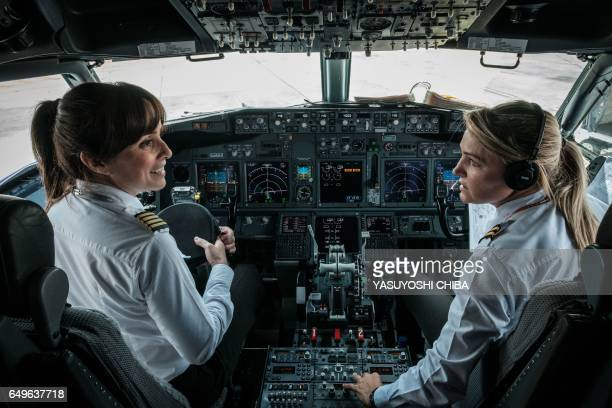 Brazilian airline GOL pilot Gabriela Carneiro Duarte and her copilot prepare to take off on an all female crew flight to mark International Women's...