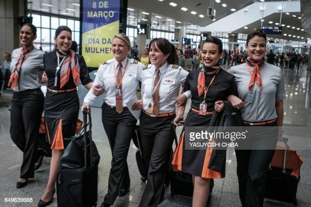Brazilian airline GOL pilot Gabriela Carneiro Duarte walks with her crew at Tom Jobim international airport in Rio de Janeiro Brazil before departing...