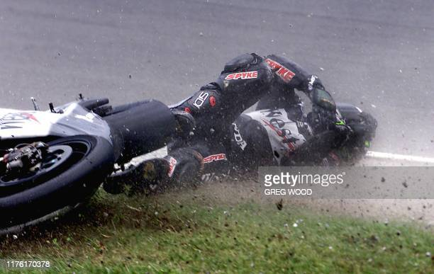 Brazilian Alex Barros slides along the Phillip Island track after losing control of his 500cc Honda during the final qualifying session at the...