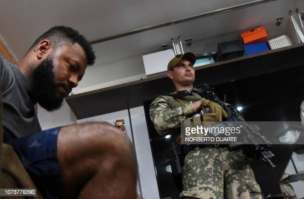 Brazilian alleged drug trafficker Carlos Enrique Sales Cardoso is escorted by a soldier during his arrest at his house in Asuncion on December 15...