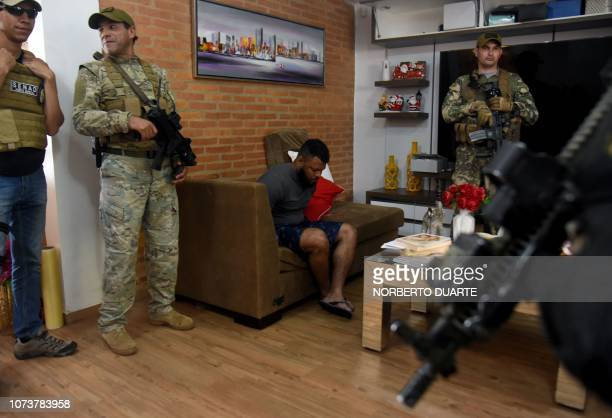 Brazilian alleged drug trafficker Carlos Enrique Sales Cardoso is escorted by soldiers and a National AntiDrug Secretariat officer during his arrest...