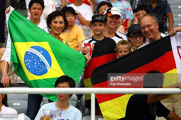Brazilian and German supporters display their national flags prior to the Women's Semi Final match between Brazil and Germany at Shanghai Stadium on...