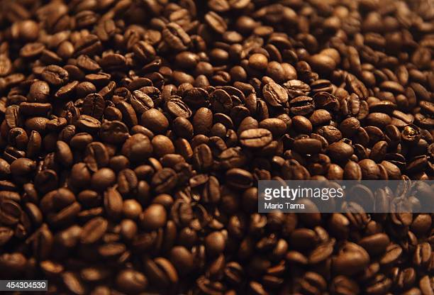 Brazilian Arabica coffee beans sit in a coffee shop on August 28 2014 in Rio de Janeiro Brazil Arabica coffee prices have been surging this year...