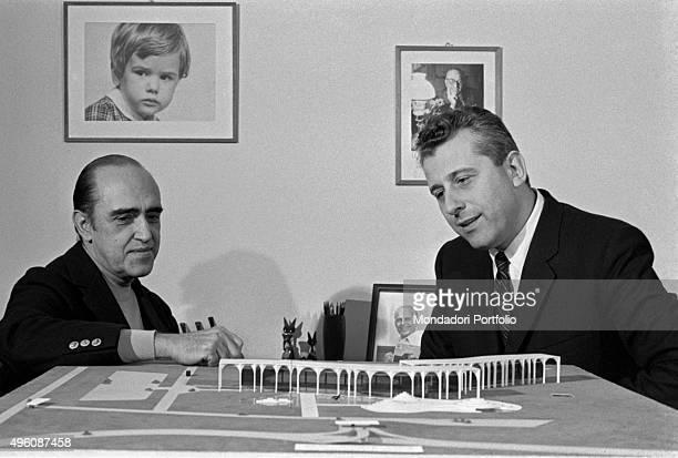 Brazilian architect Oscar Niemeyer and another man analysing the Palazzo Mondadori scale model The Italian publisher Giorgio Mondadori has recently...