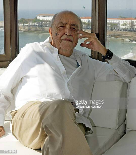 Brazilian architect Oscar Niemeyer poses for the photographer in his office above Copacabana beach in Rio de Janeiro 30 July 2003 Niemeyer received...