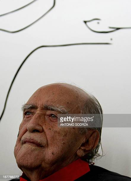 Brazilian architect Oscar Niemeyer poses in front of one of his drawings on December 12 at his studio in Rio de Janeiro Brazil Niemeyer the Brazilian...