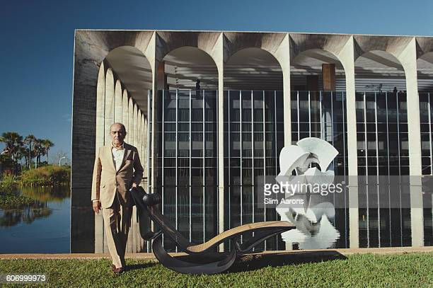 Brazilian architect Oscar Niemeyer poses outside the Mondadori headquarters in Segrate a comune in Milan Italy circa 1975 He is responsible for the...