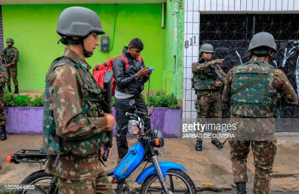 Brazilian Armed Forces soldiers stand guard in the streets of Fortaleza, Ceara state, Brazil, on February 22, 2020. - 51 homicides were registered in...