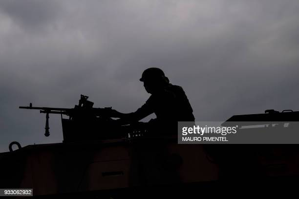 A Brazilian Army soldier patrols during a permanent operation at Vila Kennedy favela in Rio de Janeiro Brazil on March 17 2018 The chaos in the...