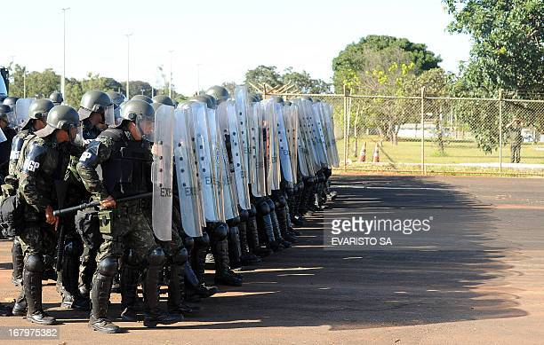 Brazilian Army soldiers in riot gear conduct a drill at the Fire Department headquarters in Brasilia on May 3 as part of the security measures ahead...